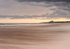 Ross beach and bamburgh castle